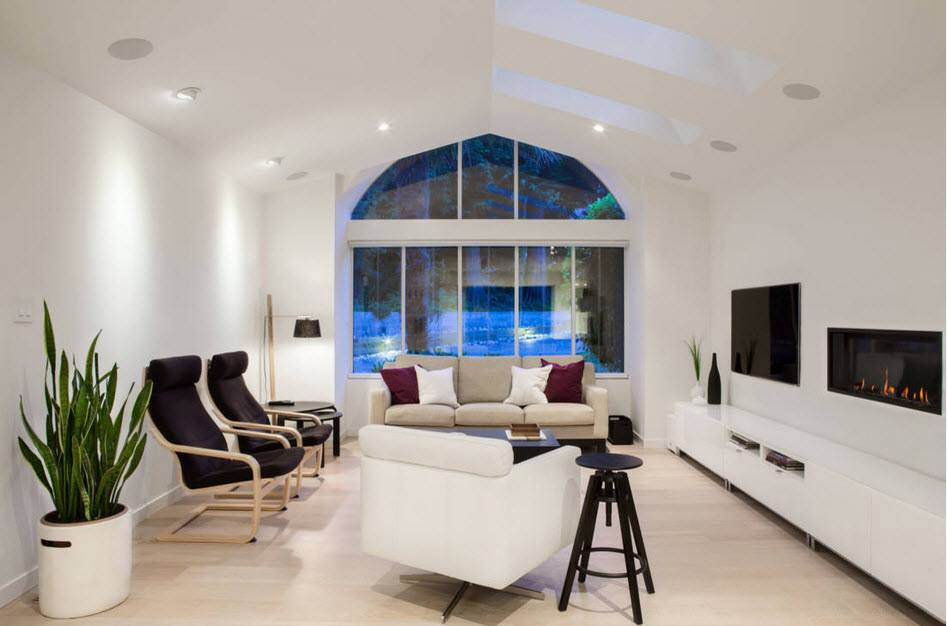 Totally white interior of the living room with large domed window