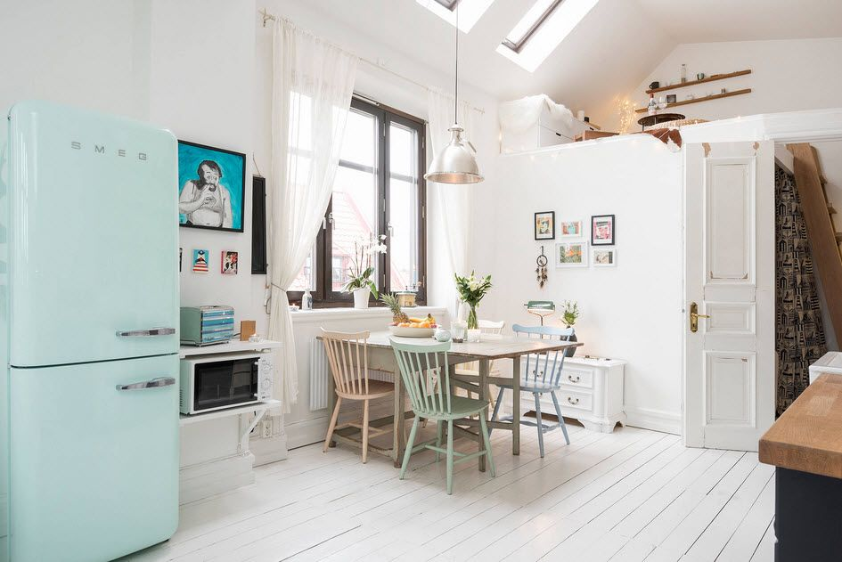 Scandinavian light decor for loft kitchen with pale blue fridge