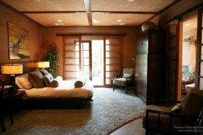 Typical Japanese interior of the bedroom with bonsai, sliding doors and light wooden palette