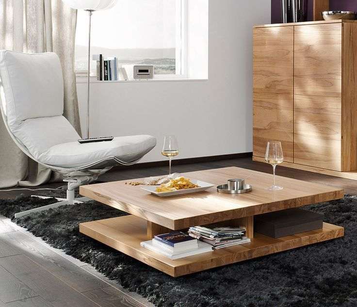 Light wooden coffee table and cabinet in the living room