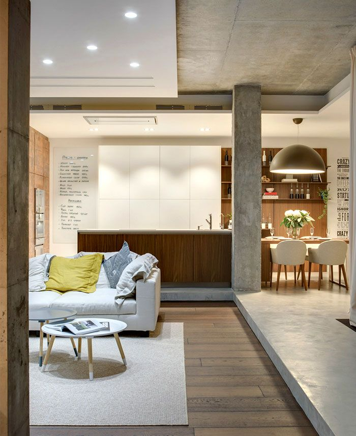 Concrete column in the large open layout apartment with bar at the kitchen