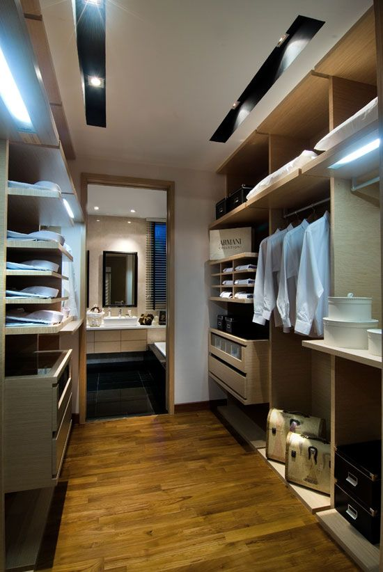 Modern designed wardrobe with dark wooden finishing