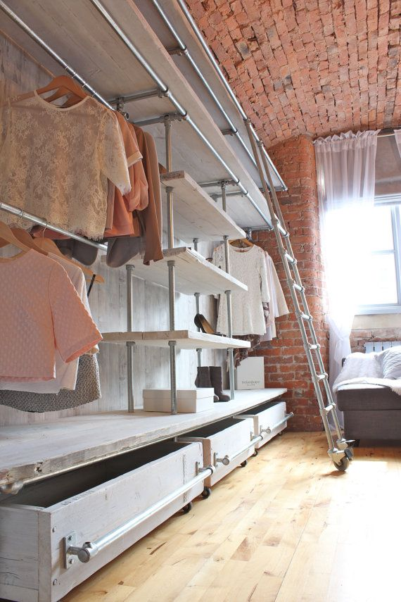 High industrial styled wardrobe with the ladder and brickwork wall finishing