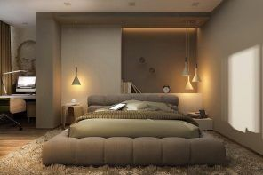 Wavy upholstered base of the low bed in modern style