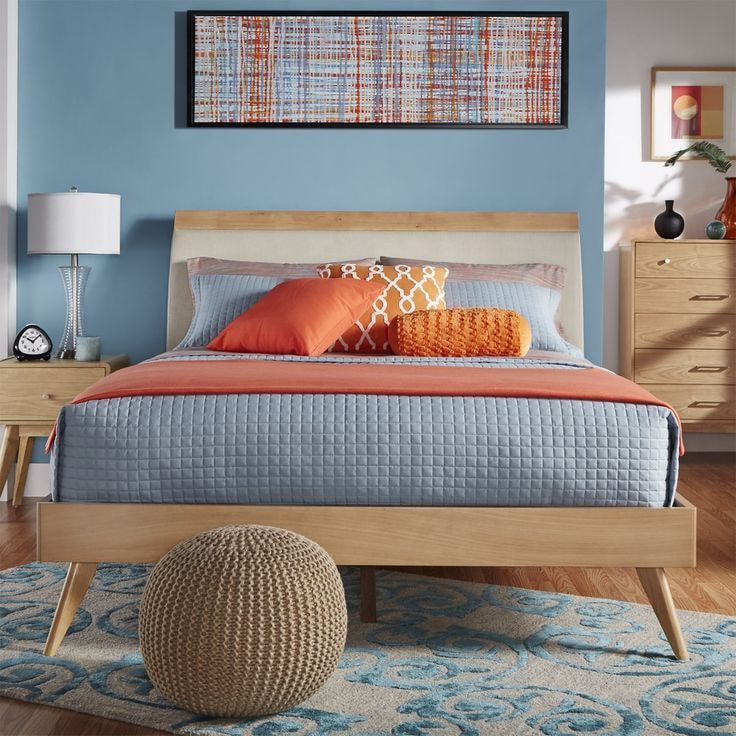 Blue walls in the casual styled bedroom