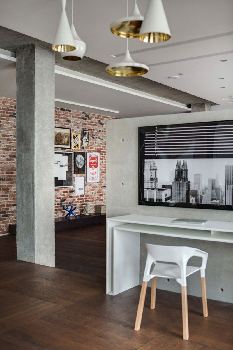 Industrial white designed open layout kitchen with concrete column in center