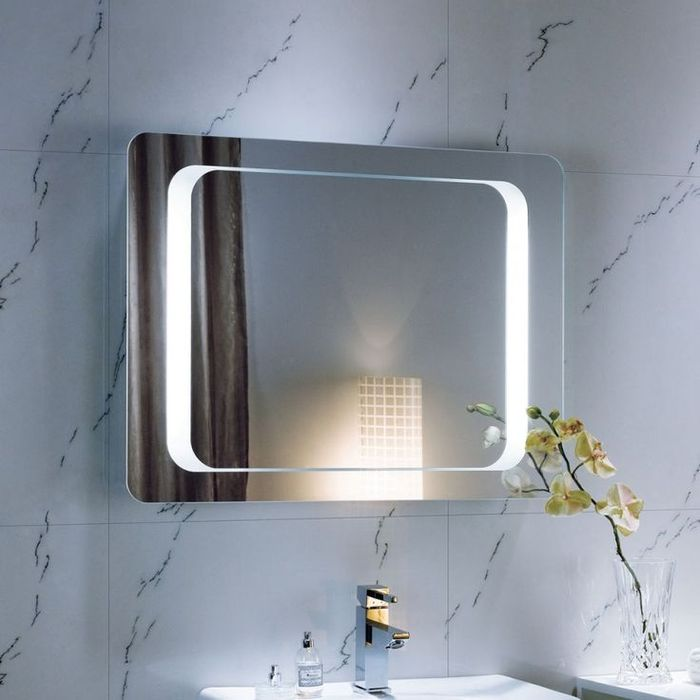 Marbled walls in the bathroom with LED lighted mirror