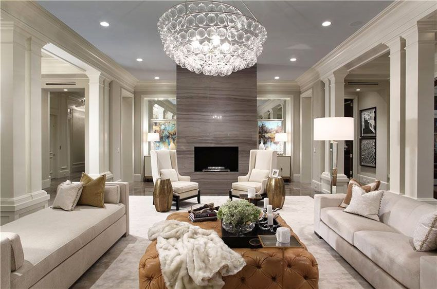 Crystal chandelier and accent wall with Tv panel in the modern living