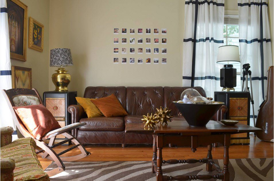 Dark leather upholstered sofa and dark wooden table in the Classic living room