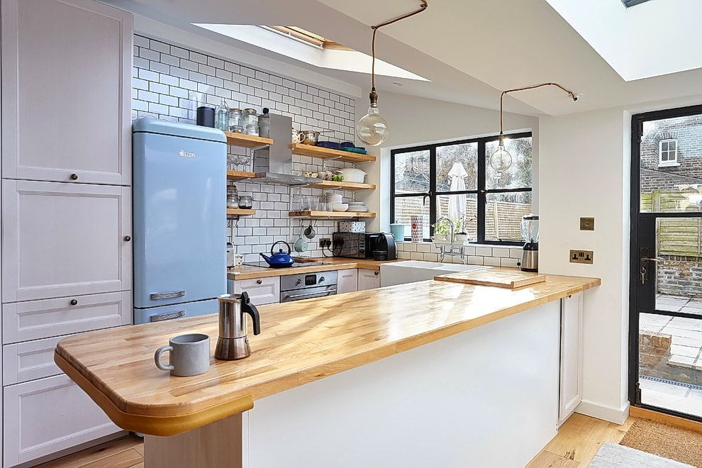 American style with light wooden countertop of the island