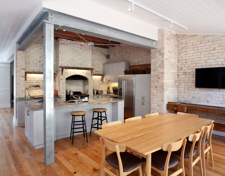Rustic setting of the kitchen with dining room with light wooden table