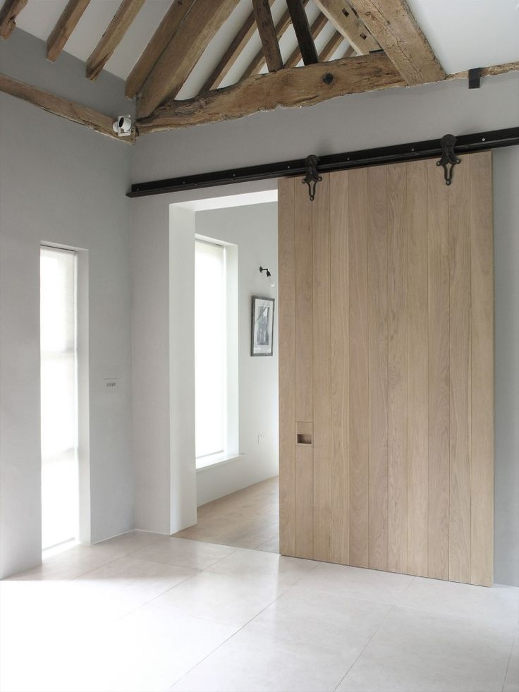Sliding wooden door in the modern cottage