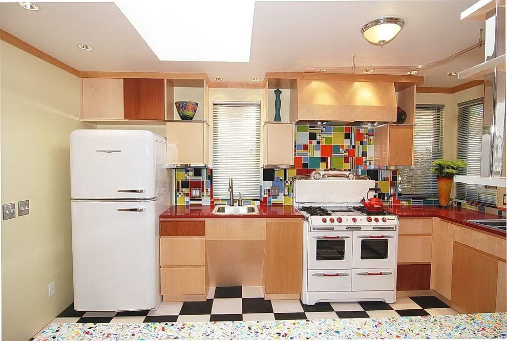 White appliances in the wooden decorated space