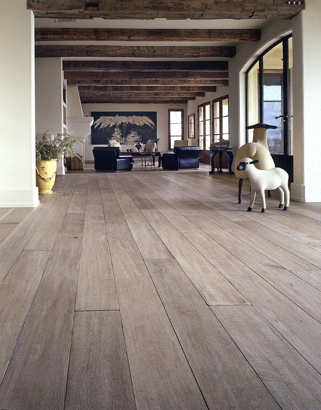 Dark wooden floor finishing at the open layout apartment