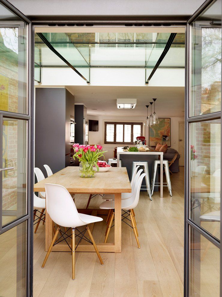 Glass and steel for the modern cottage entry to the dining zone