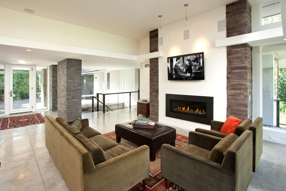 Contemporary styled living room with stone trimmed columns and fireplace