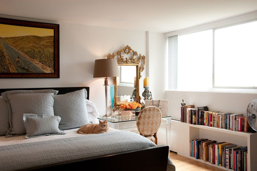 White interior design of the bedroom with vintage furniture and carved mirror