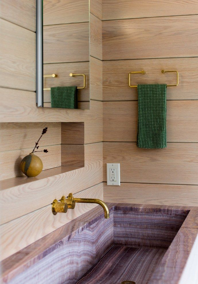 Modern design of the bathroom with wooden trimming