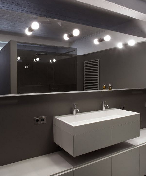 Panoramic mirror with top lighting in the bathroom
