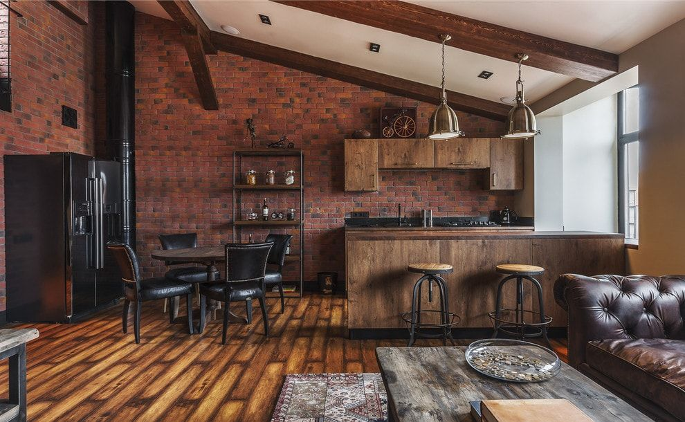 Brutal industrial design for large apartment under the roof