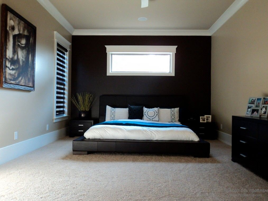 Striking idea of dark bed and accent black wall at the hradboard with the window