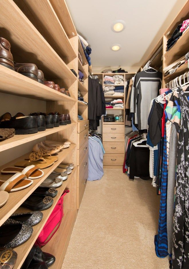 Creamy colored wardrobe with open shelves and hangers