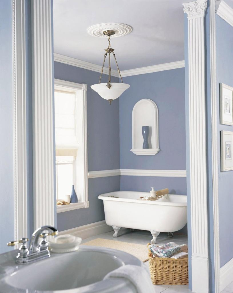 White classic bathtub in the bluish bathroom