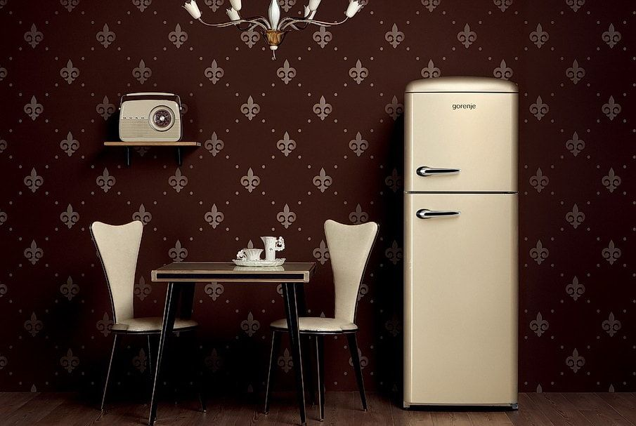 Dark coffee wallpaper and light accents of furniture and fridge for Classic dining room