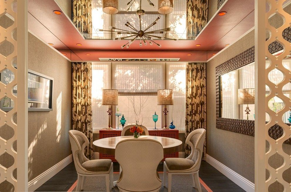 Classic styled room with upholstered armchairs, unusual colored curtians and mirror tray ceiling