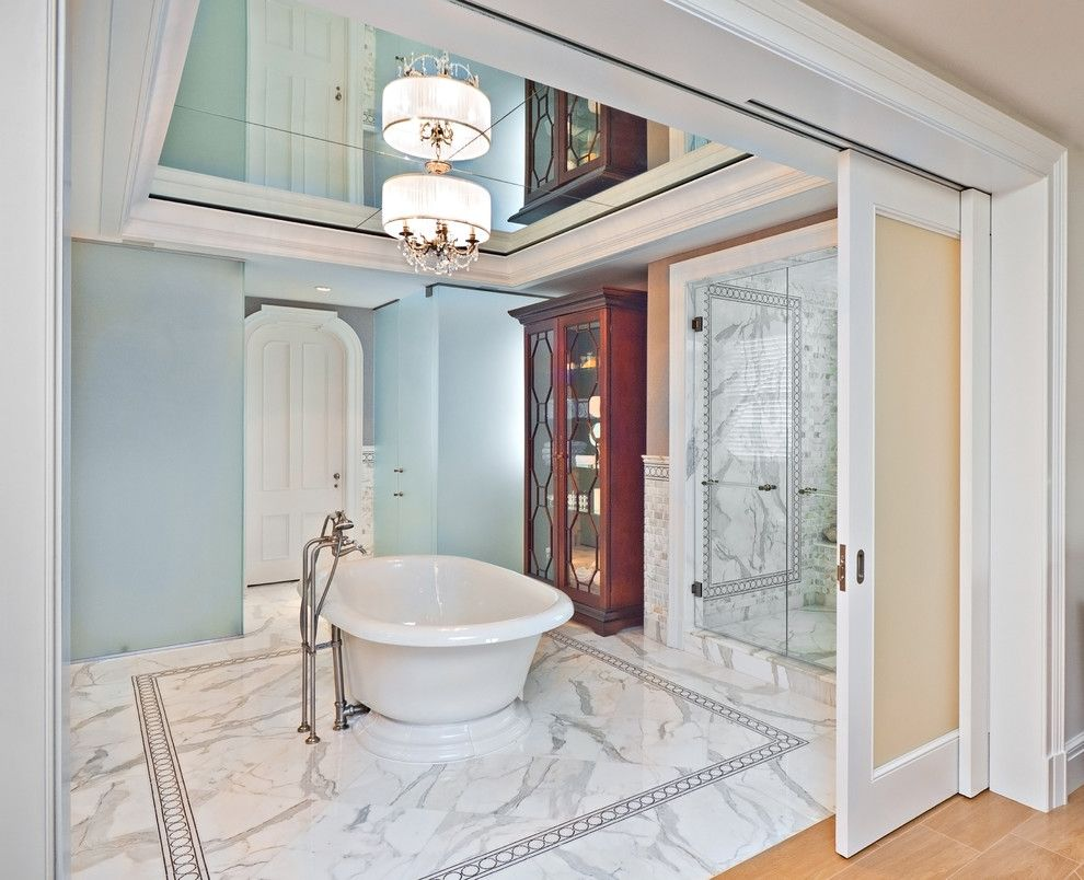Noble Classic bathroom interior with Turquoise walls, marble zoned bathtub and mirror ceiling