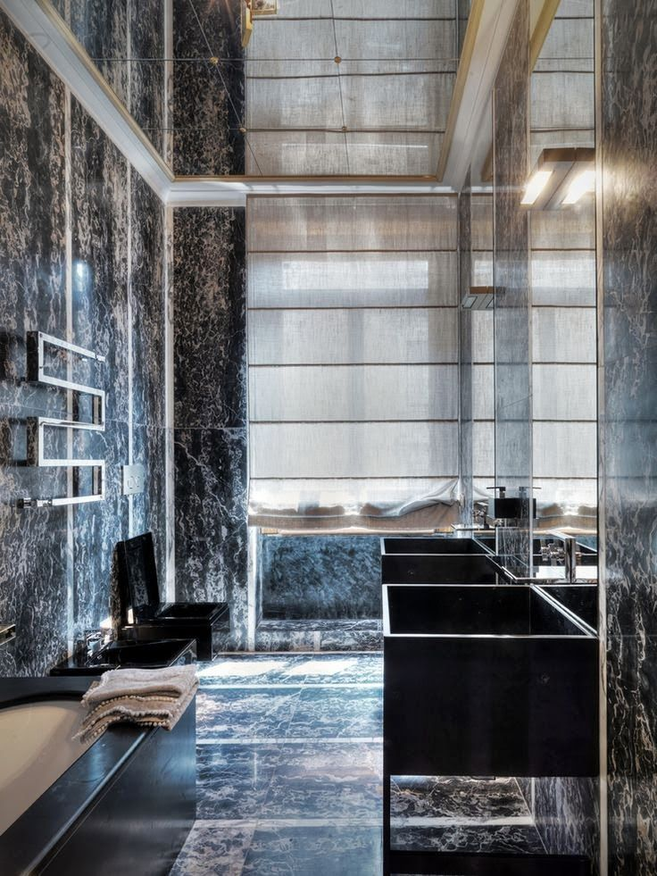 Unique bathroom design with dark bathtub, marbled walls and mirror ceiling