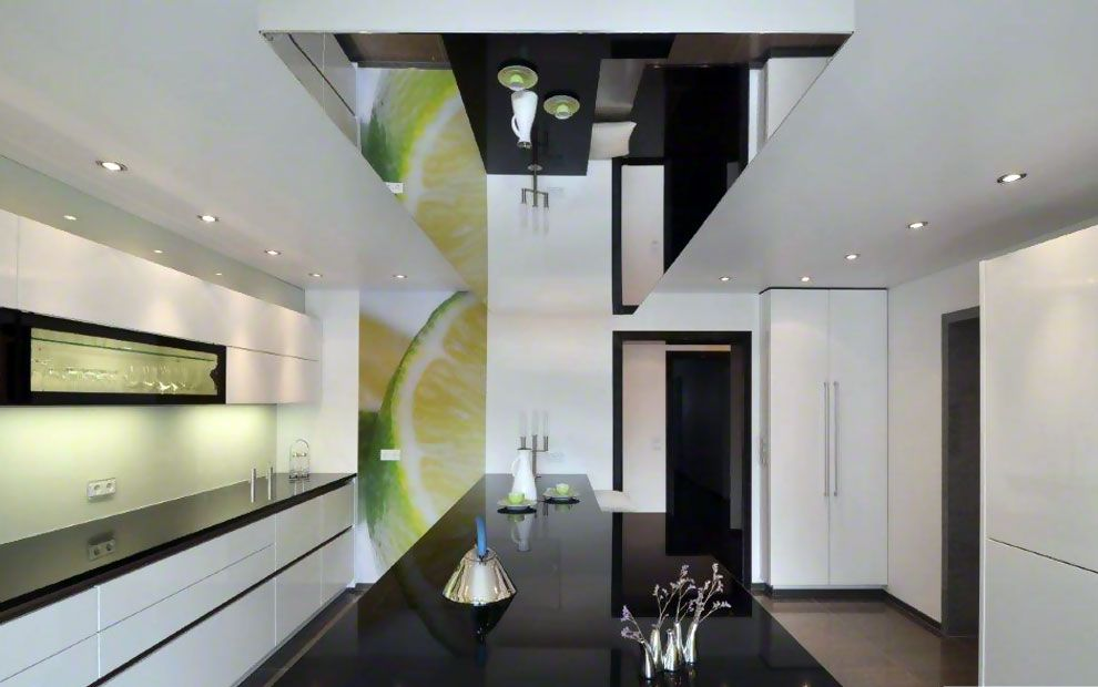 Lime print in the modern designed kitchen with black table and mirror ceiling zone above it