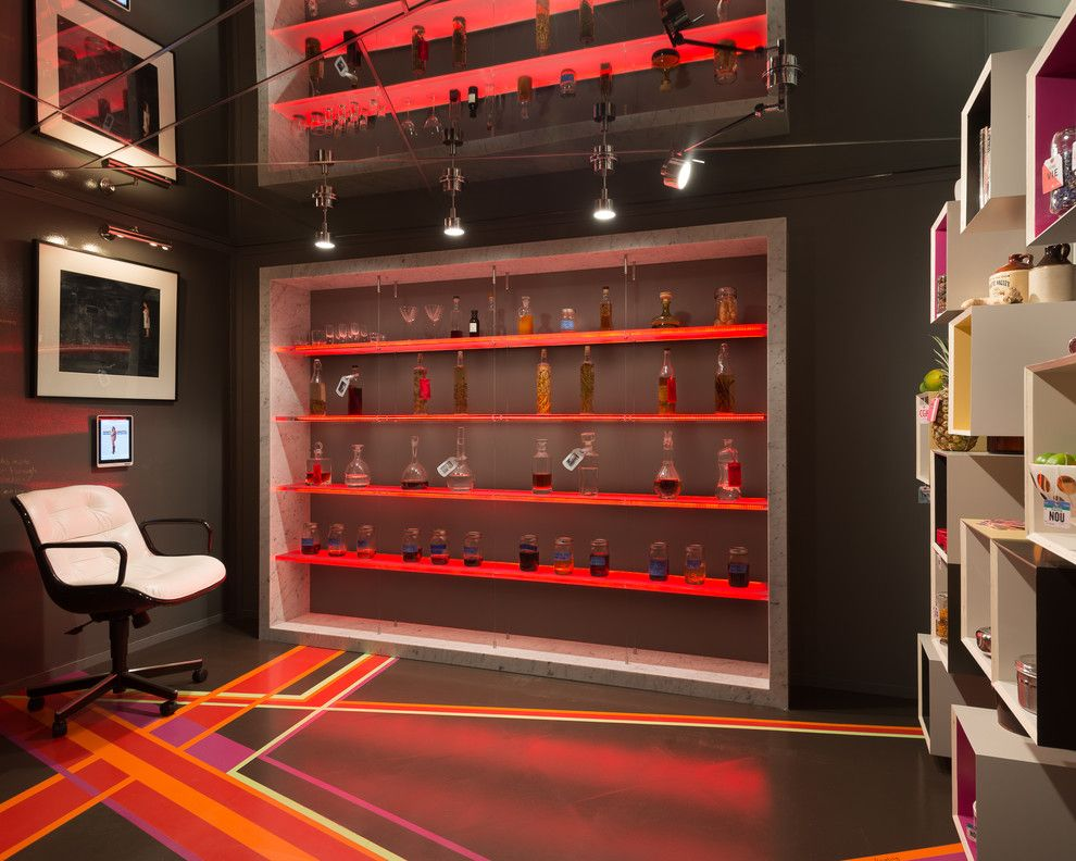 Red lighting of the shelving in the room with mirror ceiling