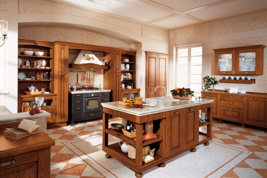 Large kitchen with central part in the from of wooden island with storage