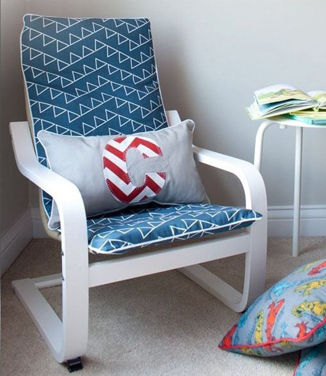 Blue upholstered poang armchair