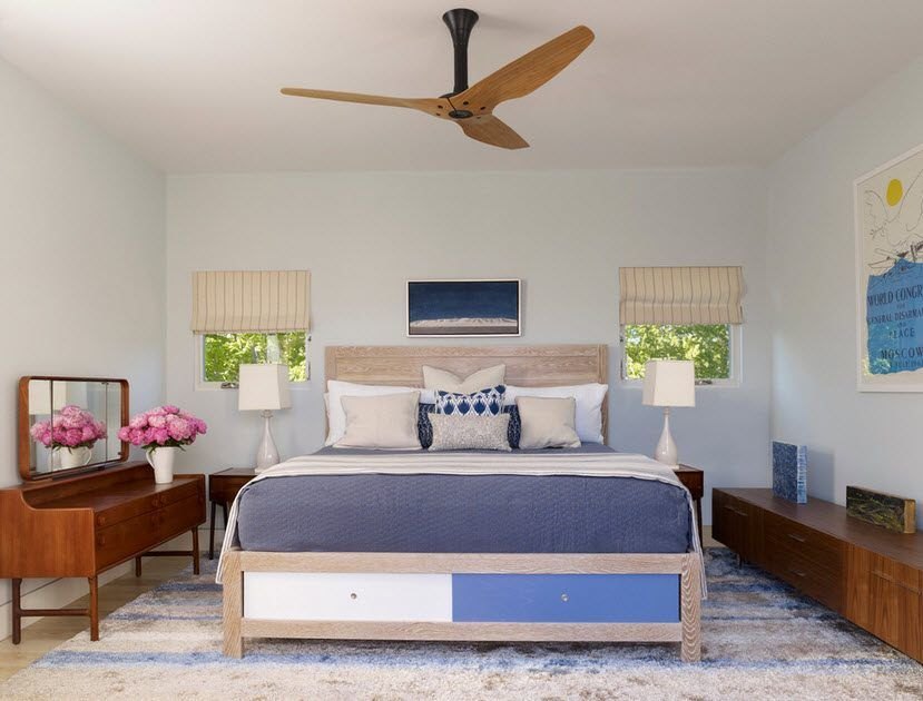 Large bed with storage system under the sleeper in the American styled bedroom