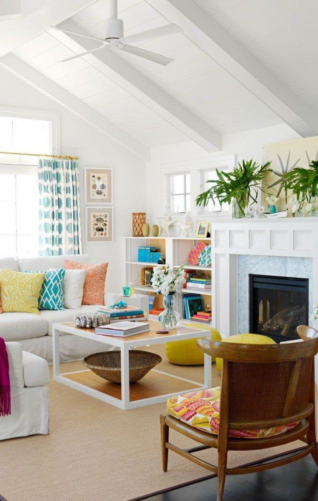 Open ceiling beams and the white trimmed fireplace