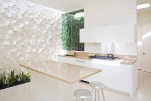 Complex designed structural wall of speckless white interior fo the modern kitchen