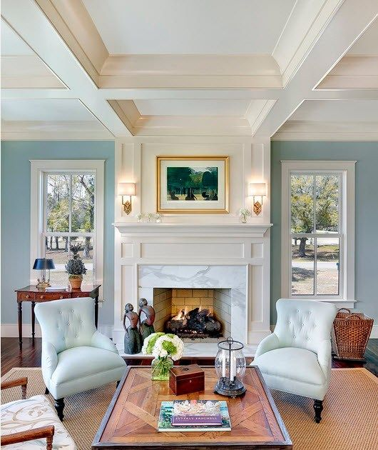 Square ceiling structure and the fireplace for neat Classic styled living room