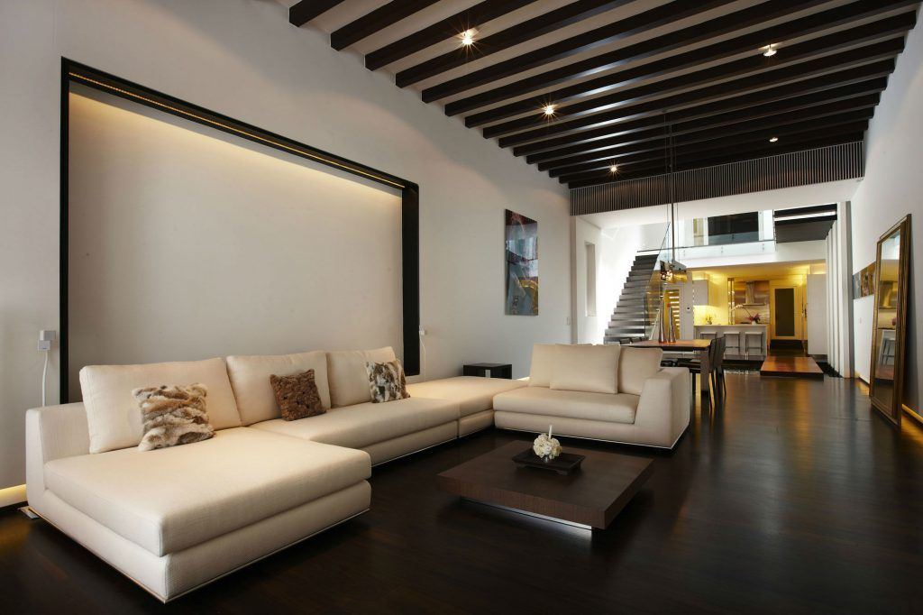 Chocolate color decoration for modern designed living room with open ceiling beams