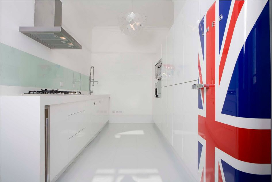 Ideally white glancing interior of the modern kitchen with British flag on the fridge