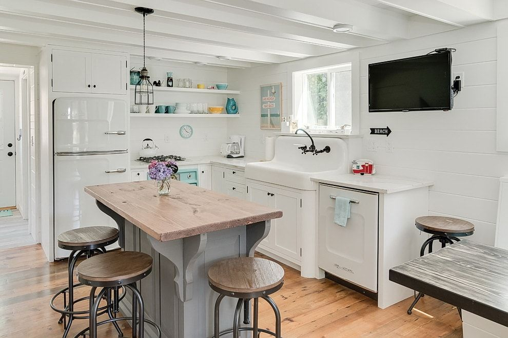 White casual kitchen interior decoration with marble countertop of the island
