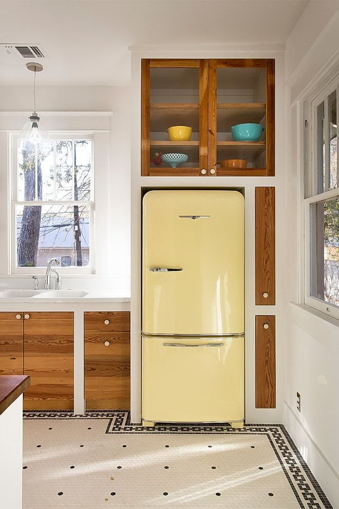 Unusual mustard colored fridge in the special shelve