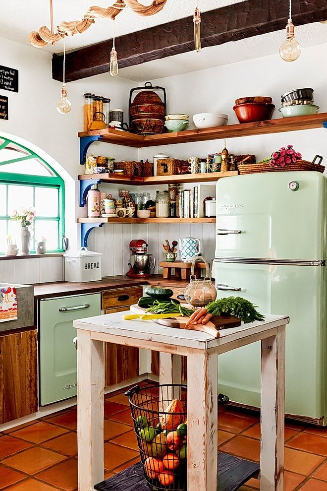 Rustic design of the kitchen with green olive colored freidge and stove