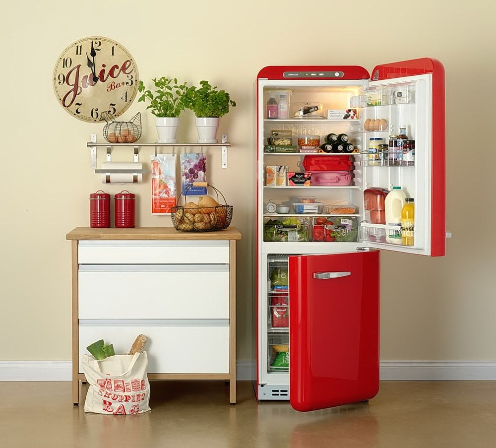 Small kitchen set of the cupboard and red fridge