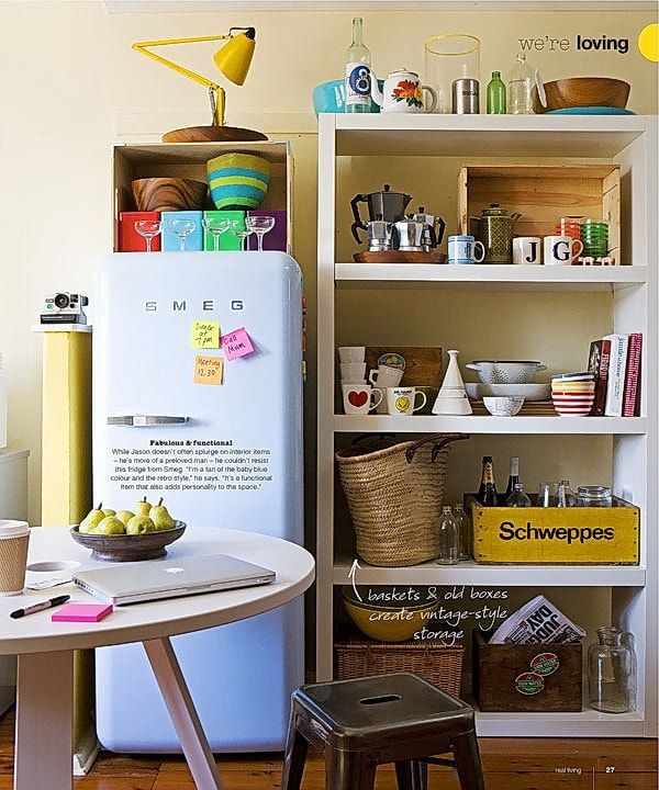 Open cupboards with stuff and Classic styled refrigerator