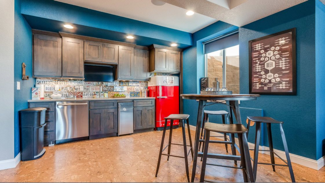 Blue targeted decoration o the kitchen with red fridge and linoleum on the floor