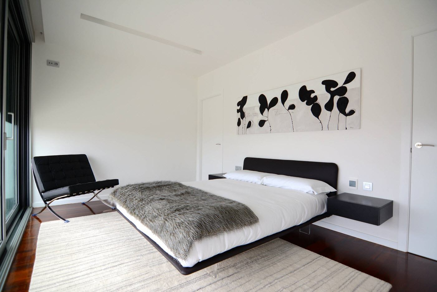 Hovering platform bed in the light designed bedroom with expression at the headboard