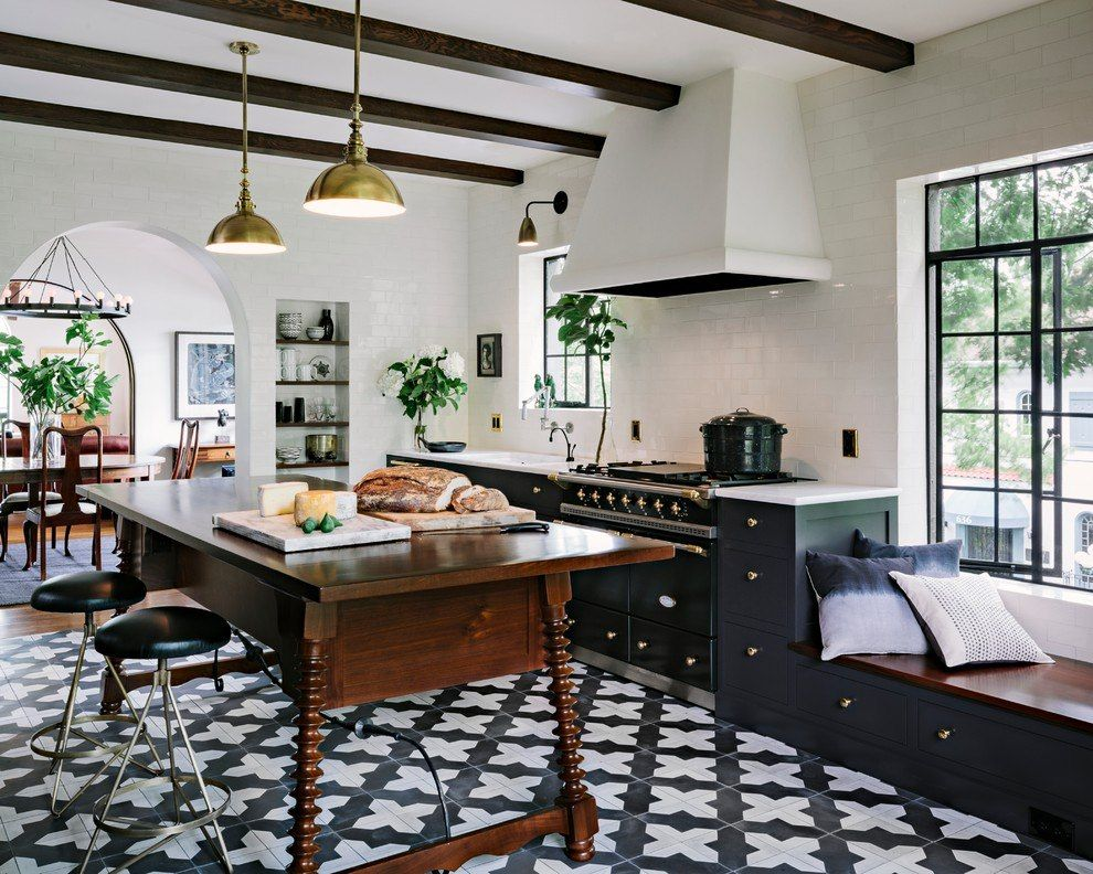 Contrasting interior for the mid-century styled kitchen with dark open ceiling beams