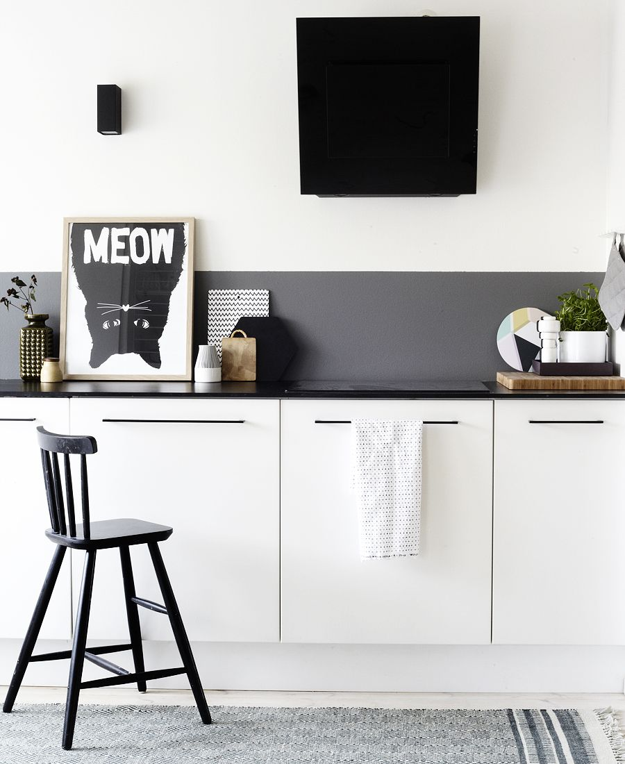Minimalistic kitchen atmosphere with black chair and backsplash